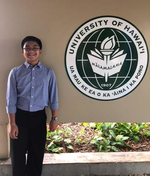 Seanne beside University of Hawaii crest