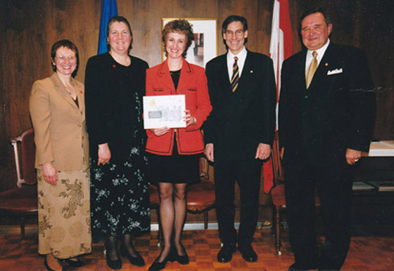 Jacqueline Ryz with Lieutenant Governor of Manitoba Peter Liba, and representatives of the Red Cross