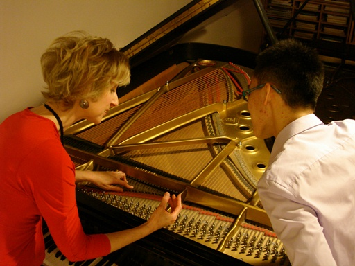 Jacqueline explaining the nner workings of the piano to a student